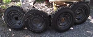 SKID STEER TIRES AND RIMS THOMAS