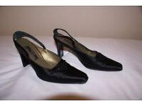 An elegant black satin fabric covered pair of sling-backed shoes by Eneo Dommini of Italy