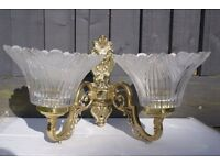 A Pair of wall lights, crystal glass and gold finish wall brackets
