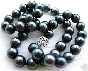 Superbe collier VRAIES perles noires paon 8mm +en nacre de mer