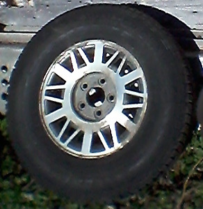 Four 235/75R15 Studded  Winter Tires on Rims