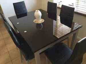 Black glass 6 seater dinning table. Meadowbrook Logan Area Preview