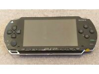 PlayStation Portable (PSP 1003) with accessories