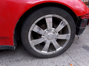 17 inch Chrome rims and low profile tires