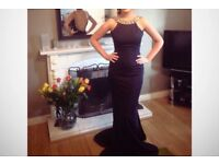 Navy Blue Formal Dress with Diamond Incrusted low back with hoop around the bottom. Size 6