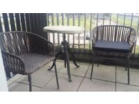 Vintage/Industrial effect Cast Iron Table that is height adjustable. Plus, 2 chairs with cushions