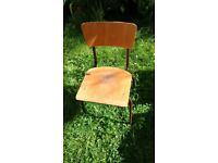 Little wooden chair with metal legs