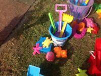 Beach toys, buckets, spades, shapes etc.