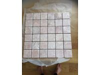 Mosaic travatine tiles, 25 new tiles, all on mesh backing. Each tile is 30cm X 30cm.