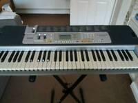 Casio LK-110 keyboard and stand with keylighting system