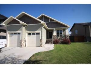 Beautiful home backing on to green strip in Coaldale