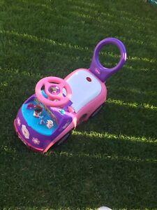 Doc Mcatuffins push a car toy