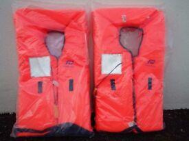A pair of unused Plastimo Lifejackets