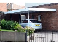 Carport with metal frame and clear corrugated plastic roof