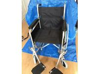 Wheelchair. As new, used once. Lightweight, folding.