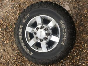 2015 GMC 2500 HD factory rims with 35 x 12.5 R 18 set of 4