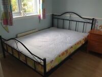 Double bed with mattress and bed side cabinet