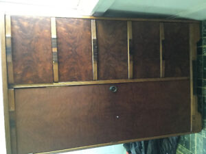 Not sure of age. It is a laminated dresser/wardrobe in good cono