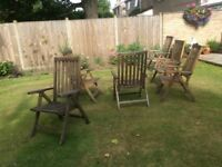 Six hardwood reclining garden chairs with cusions