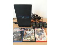 Playstation 2 with 3 games and 4 buzz controllers