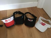 Various running visors and caps for sale