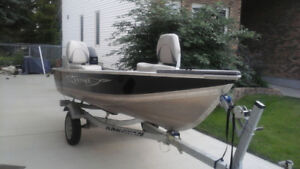 12 foot Lund boat with 9.9 Merc 4 stroke and trailer