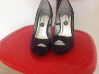 Black diamanté high heeled shoes
