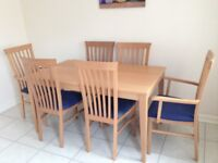 Dining room table and 6 chairs (2 with arms)