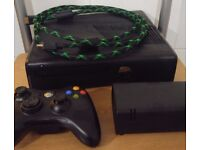 Matt Black (4gb) Xbox 360 slim and 250gb hdd. Inc controller, hdmi, original AV and plug.