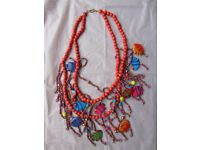 Funky handcrafted colourful neck pieces with fish design