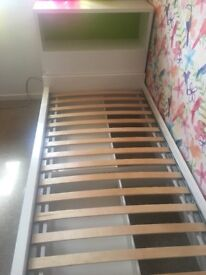 Single bed (IKEA) with headboard / shelves and integrated bedside cabinet. Excellent condition.