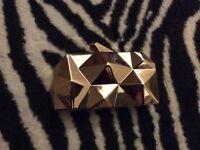 Golden architecture evening clutch