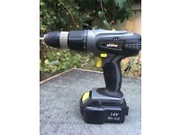 Cordless drill with extra battery, charger and case