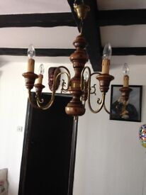 Wood and ornate brass ceiling pendant light with candle drips
