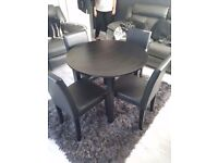 Brand knew black dining table 4 black leather chairs