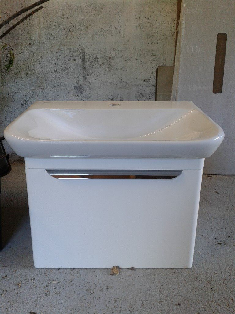 Large white bathroom sink with under storage unit
