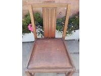 four vintage wooden chairs