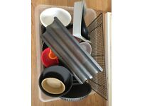 Box of baking trays, cooking dishes, racks, molds