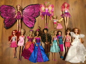 Barbie lot with extra clothes and shoes plus BMW Barbie car