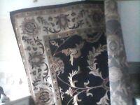 large black patterned persion rug