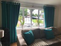 Beautiful aqua curtains hang beautifully only 6 months old.