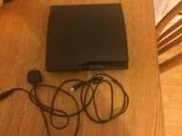 PS3 SLIM 160GB WITH 2 CONTROLLERS AND 8 GAMES