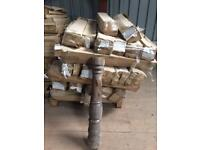 Pallet of wooden turned table base columns