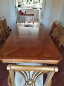 Dining room table with chairs and sideboard