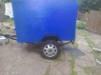 A car trailer 5feet x4feet 3feet highe leaf springs rear