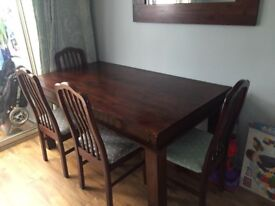 Dark wood table and six chairs