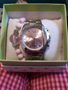 Rose gold and silver colored watch
