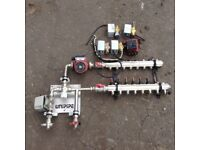 Underfloor heating manifold zone valves and circulation pump