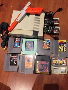 nes system and 8 games - gun 31 in 1 / Mario