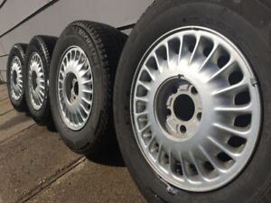 4 Michelin x ice 205/70r15 tires on Buick rims like new!!